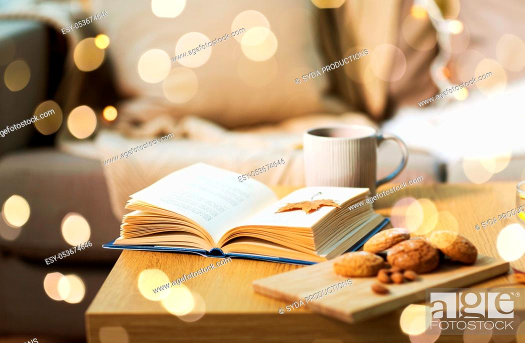 Stock Photo: book with autumn leaf, cookies and tea on table.