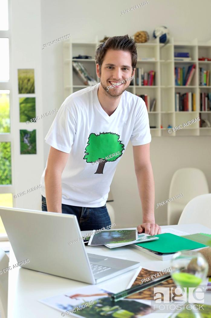 Stock Photo: Man working on environment awareness posters.