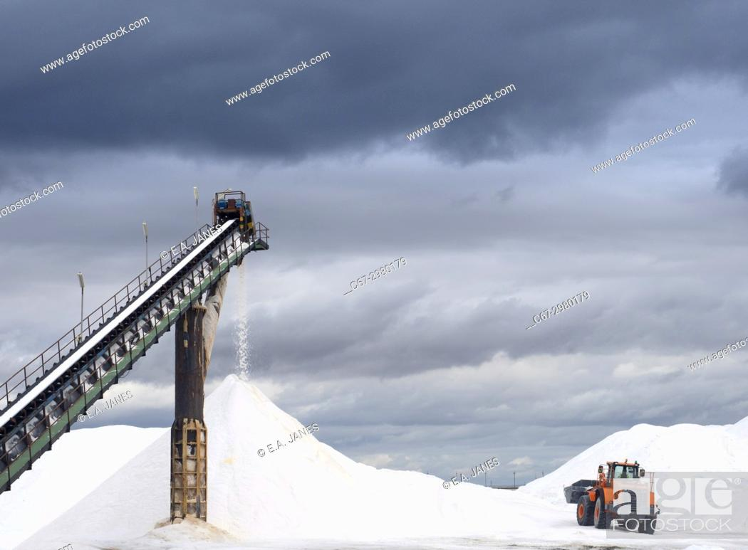 Stock Photo: Salt being processed and broken down by machinary in Spain.