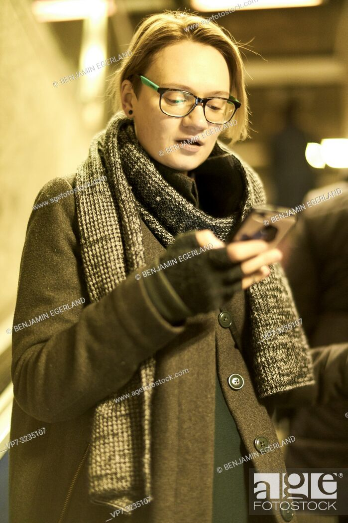Stock Photo: woman in city using smartphone, in Munich, Germany.