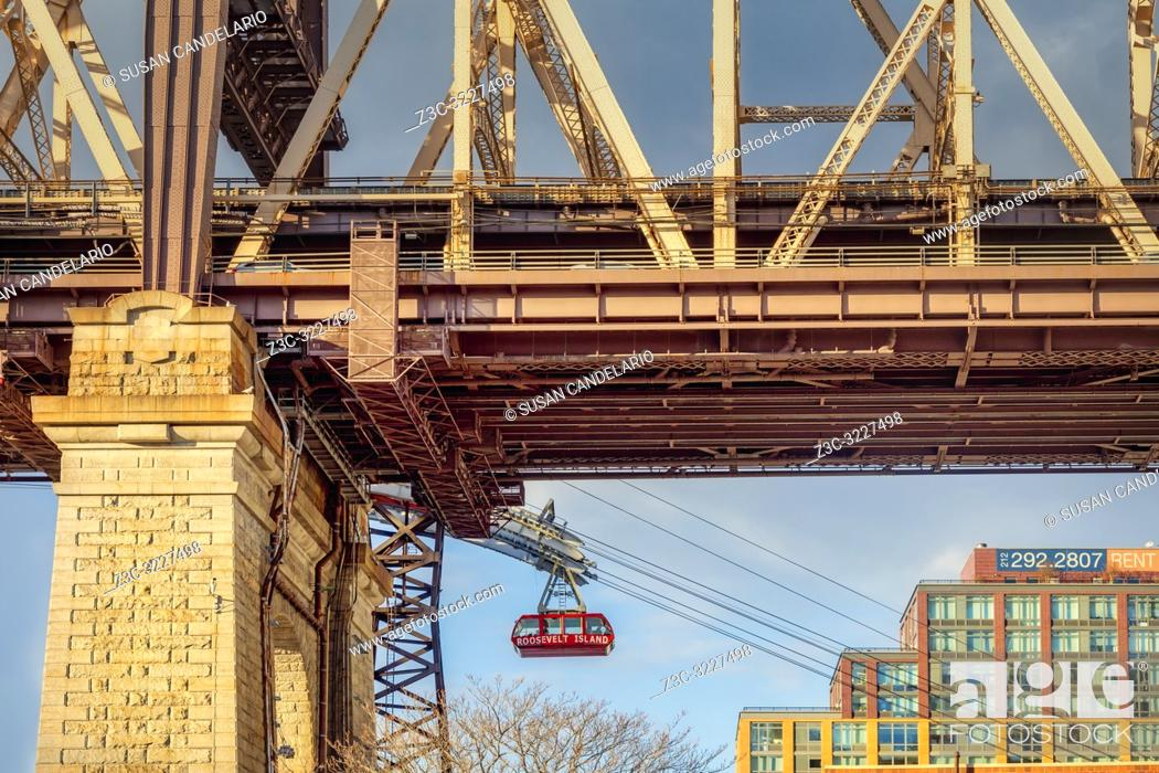 Stock Photo: Roosevelt Tram Underneath The 59 St Bridge - View from beneath the Ed Koch 59th Street Queensboro bridge with the red Roosevelt Island tramway. .