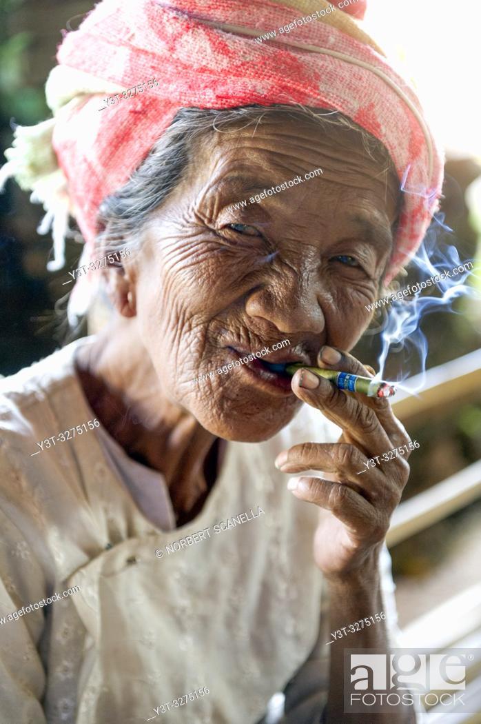 Stock Photo: Myanmar (ex Birmanie). Inle lake. Old woman smoking the cheroot the Burmese cigar.