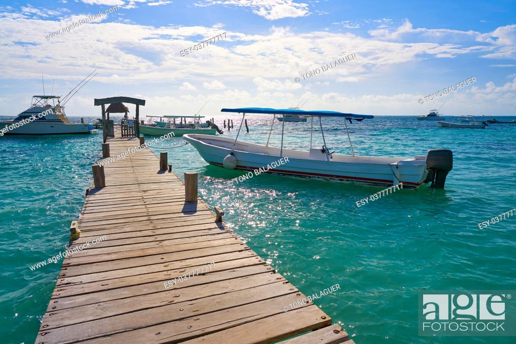 Stock Photo: Riviera Maya wood pier with Caribbean boats in Mexico.