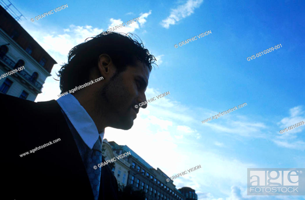Stock Photo: Young professional man looking sideway.