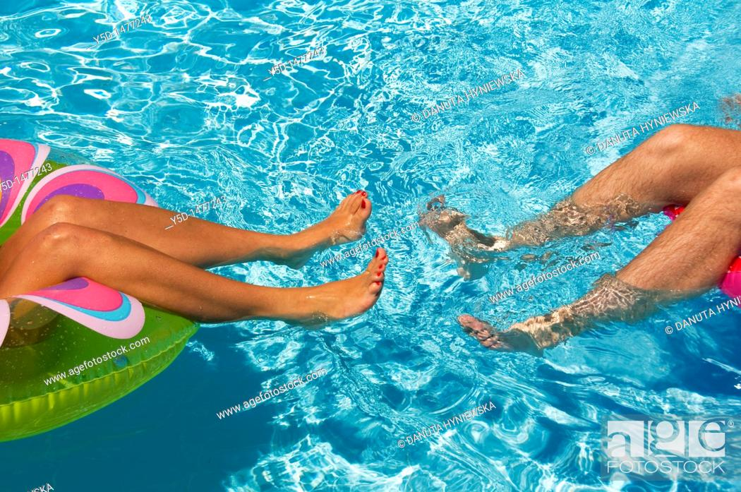 Stock Photo: begining of relationship, swimming pool, summer.