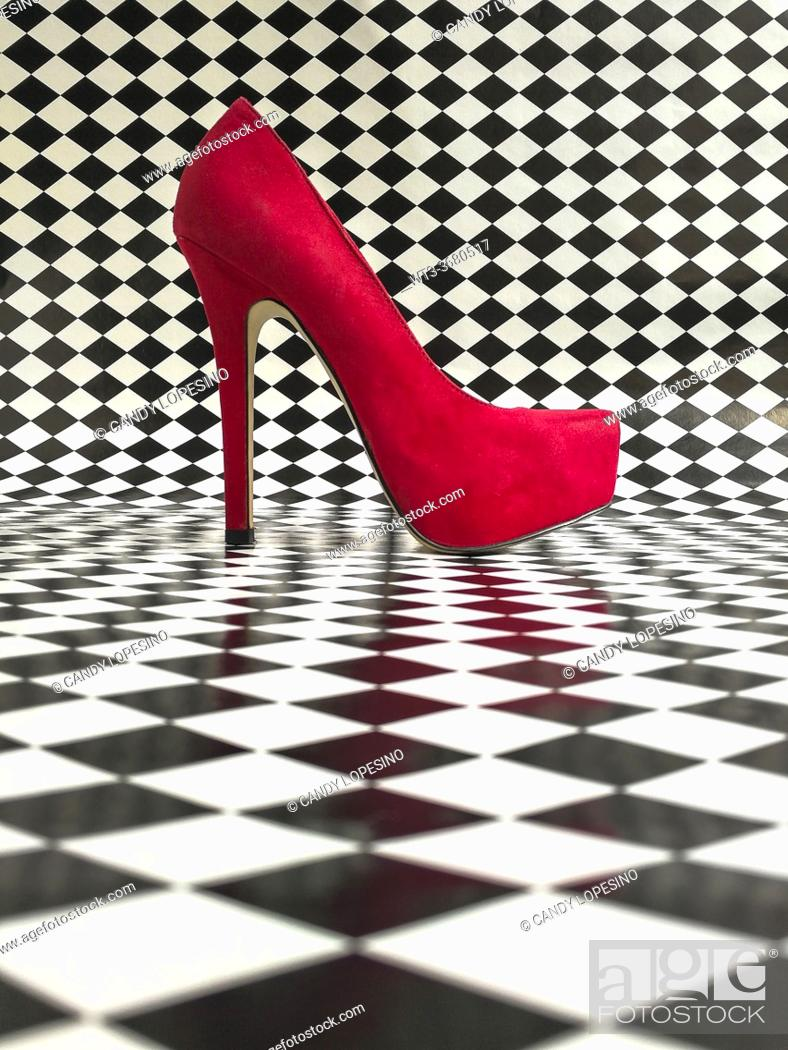 Stock Photo: Red woman shoe on black and white background.