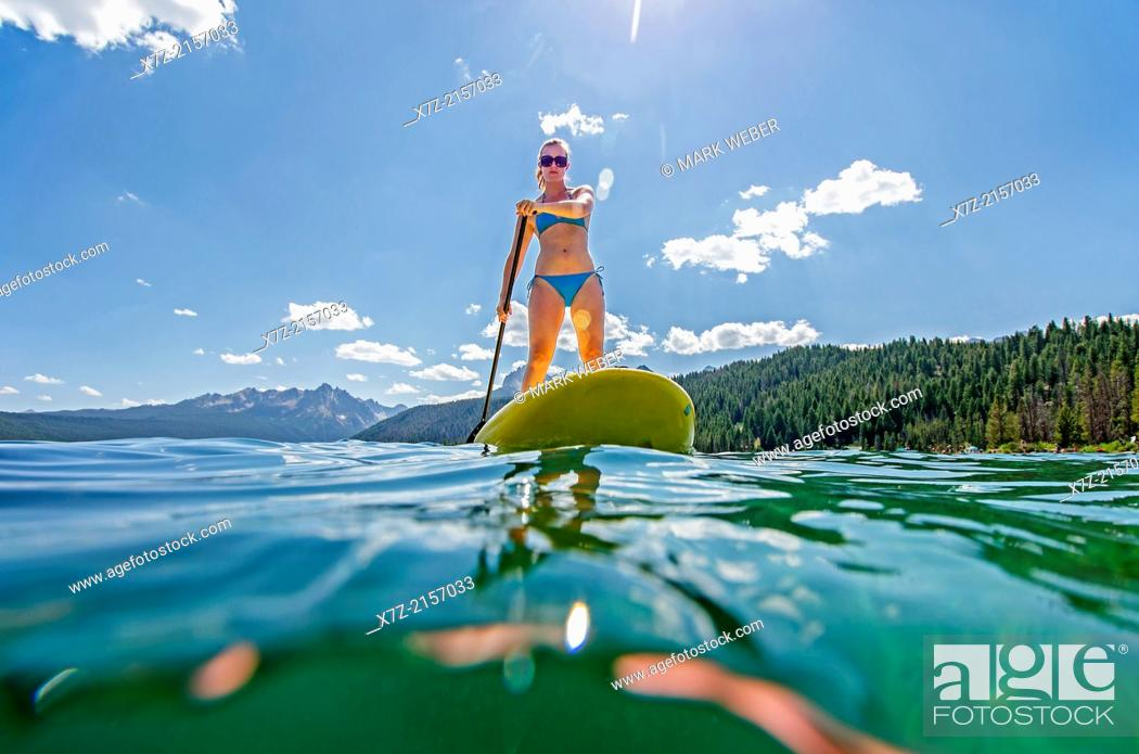 Stock Photo: touring on the Stand Up Paddle Board at Redfish Lake in the Sawtooth Mountains near the town of Stanely in central Idaho.
