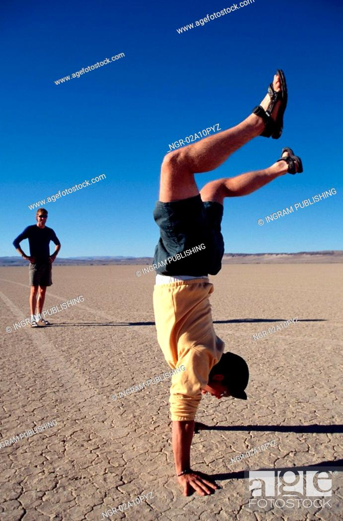 Stock Photo: man doing the handstand.
