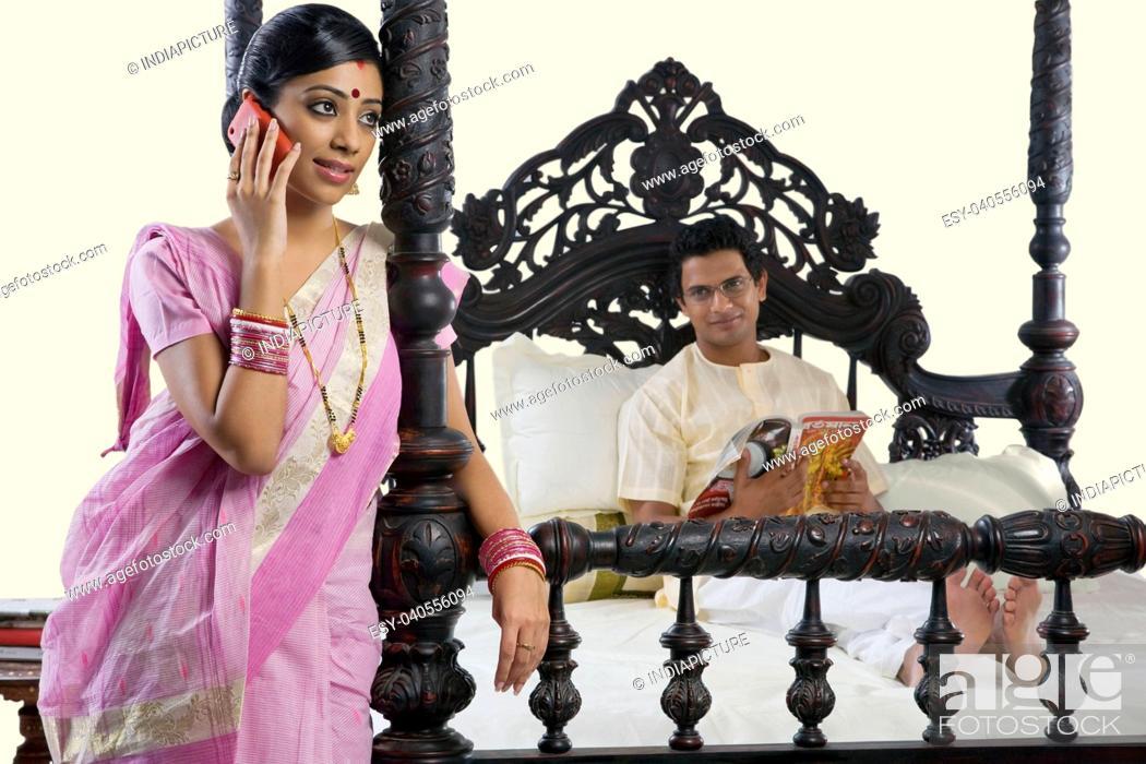 Stock Photo: Bengali woman talking on a mobile phone.