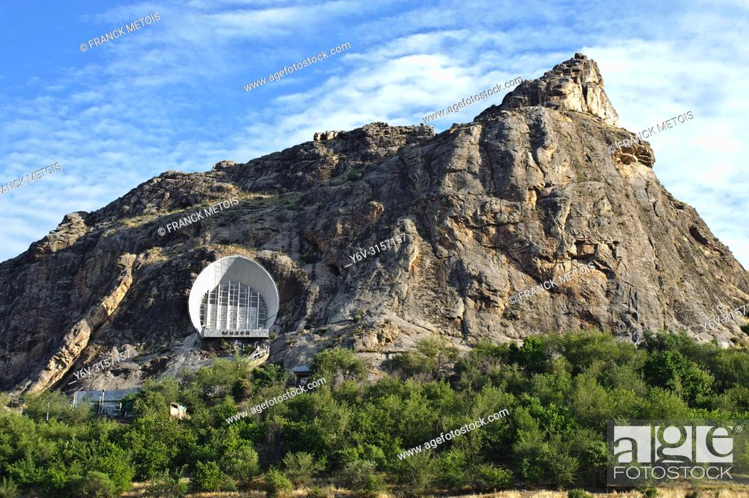 Stock Photo: Cave museum on the side of Sulaiman too hill ( Osh, Kyrgyzstan).