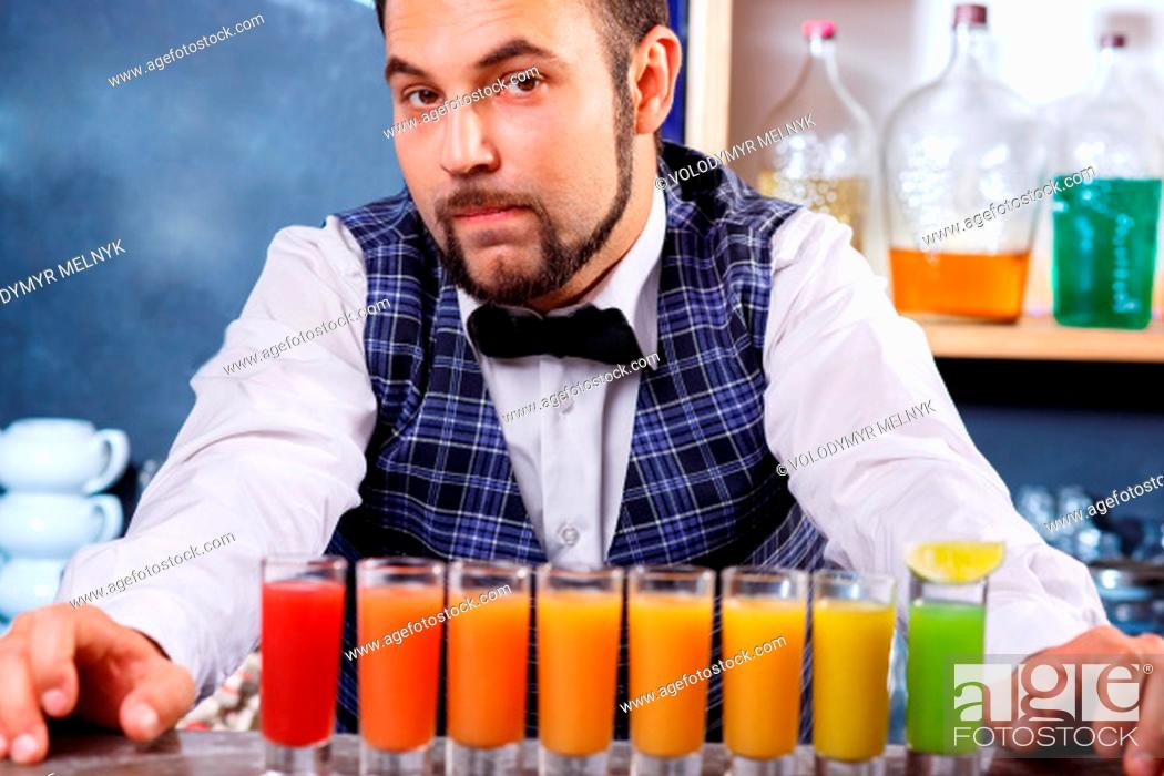 Stock Photo: The barman at work, he preparing cocktails. Concept about service and beverages.