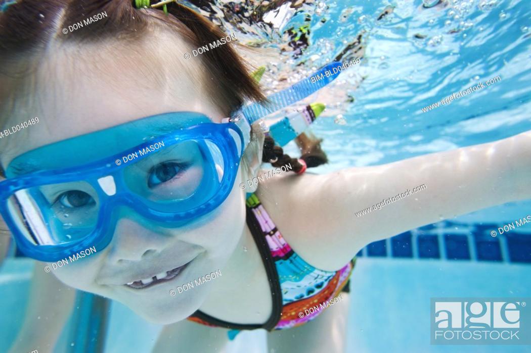 Stock Photo: Asian girl swimming under water.