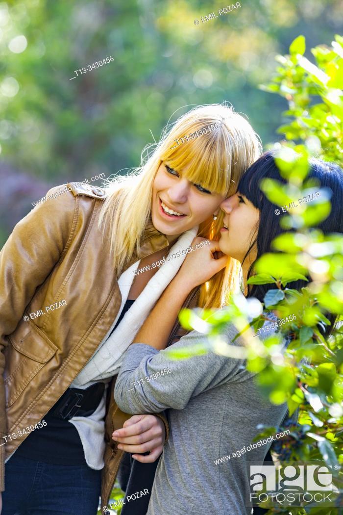 Stock Photo: Girlfriends secretive talk.