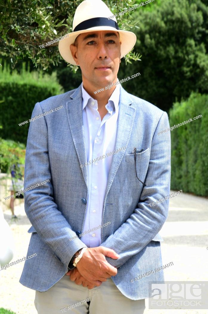Stock Photo: The artist Lorenzo Quinn during the presentation of the his artwork ' Give ' to the Boboli Gardens , Florence, ITALY-04-08-2020.