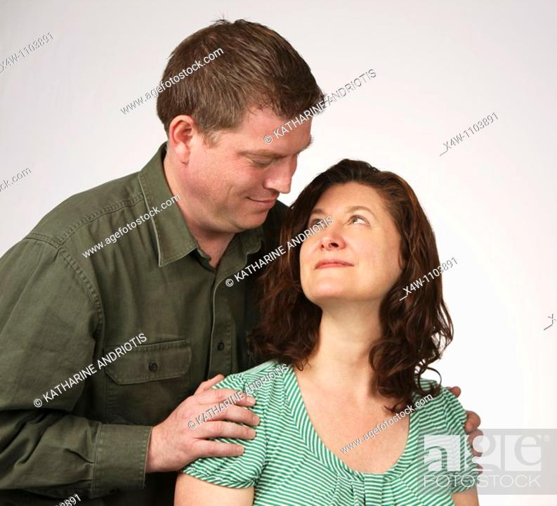 Imagen: Loving married heterosexual couple looking at each other romantically.