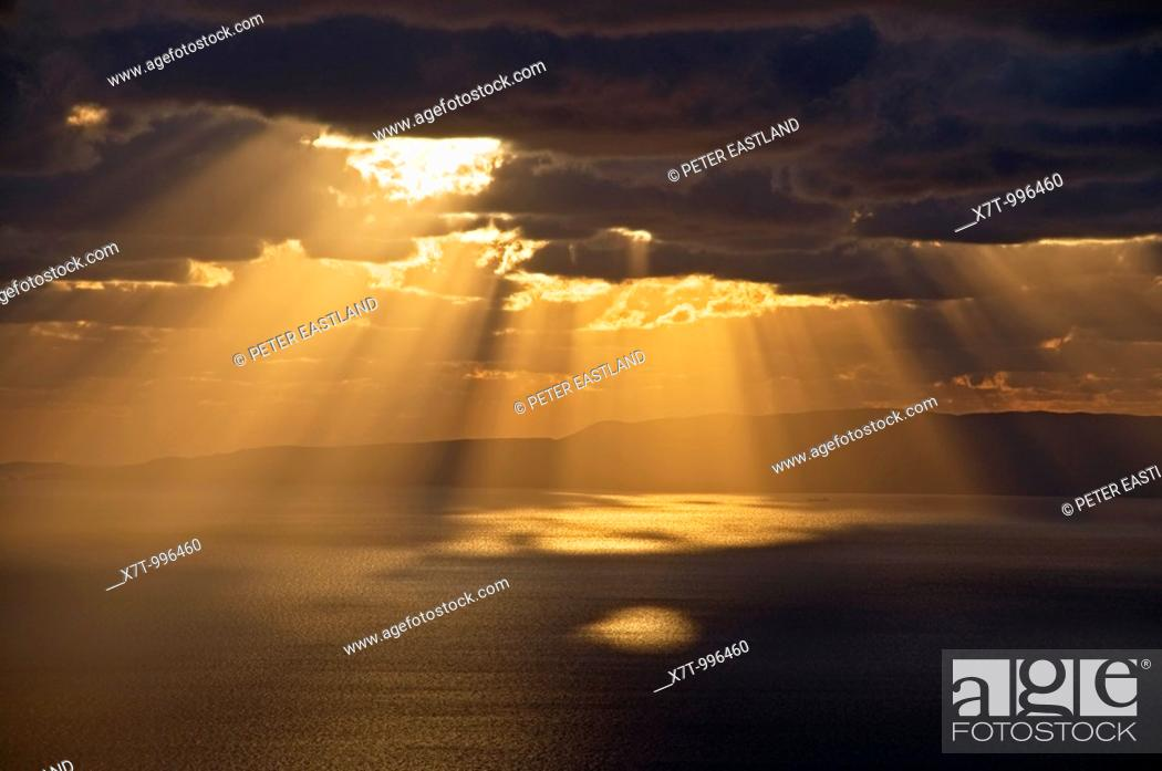 Stock Photo: Sun bursting through clouds on the gulf of Messinia near Langada in the Outer Mani, southern Peloponnese, Greece.