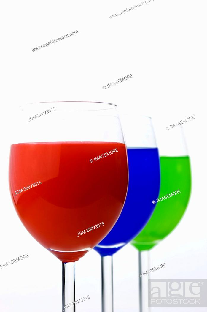 Stock Photo: Three Glasses containing different colors.