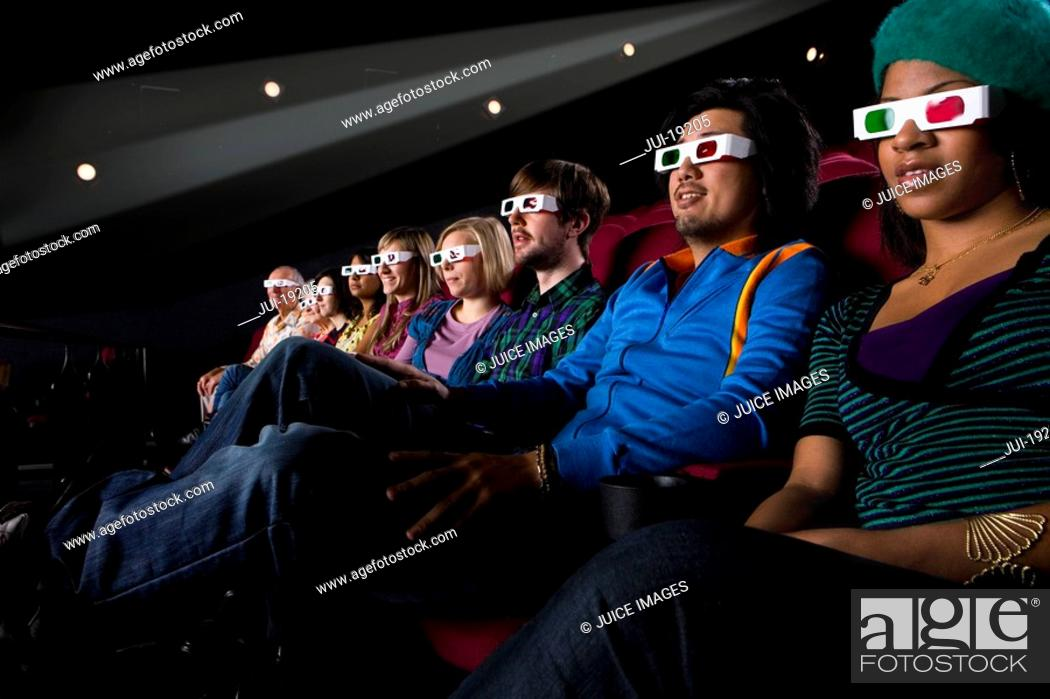 Stock Photo: Audience in cinema wearing 3D glasses, low angle view.