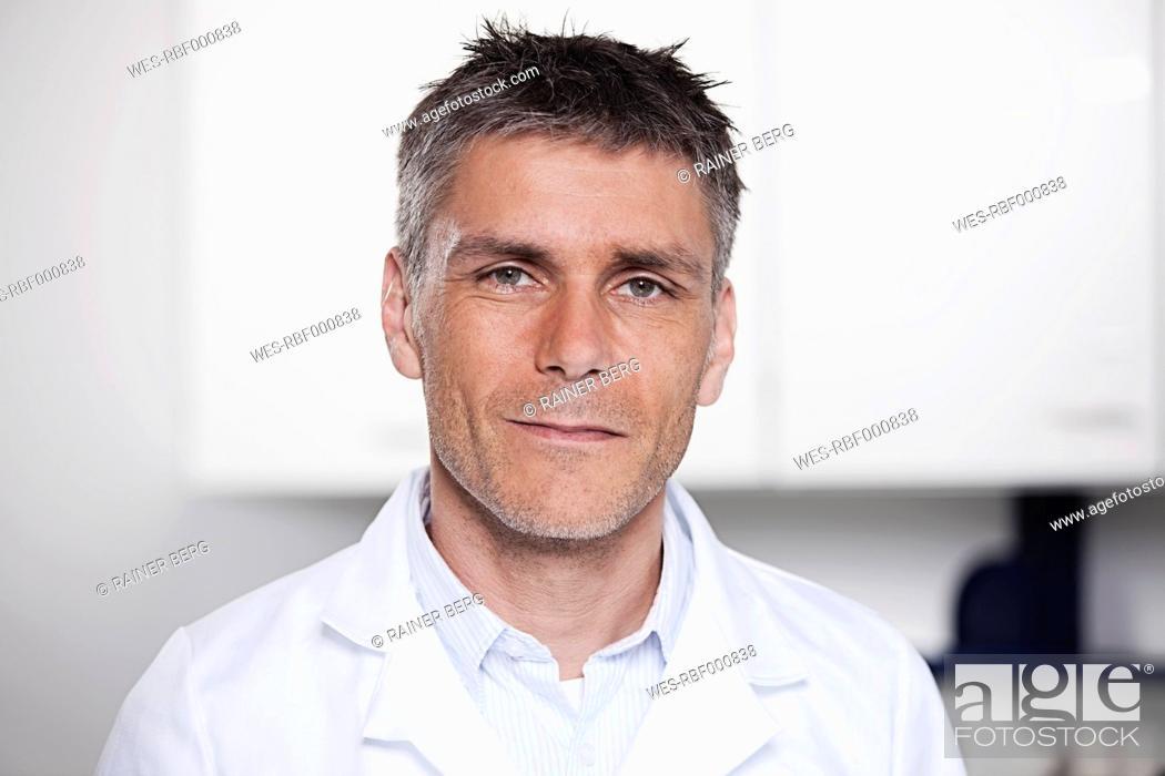 Stock Photo: Germany, Bavaria, Munich, Scientist in laboratory, portrait.