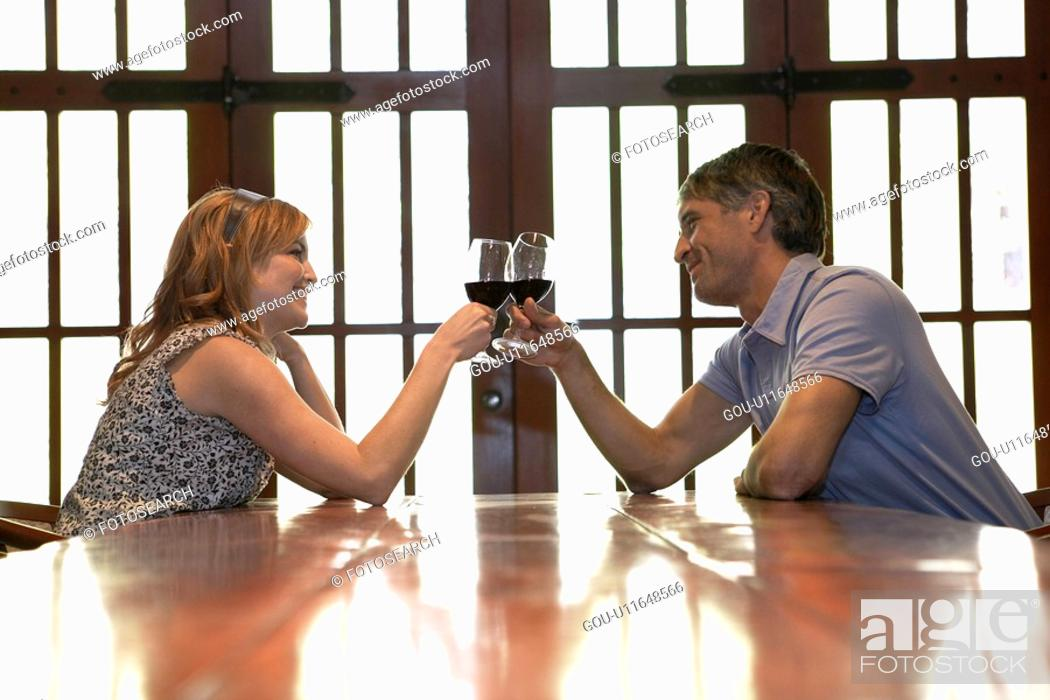 Stock Photo: Couple toasting.