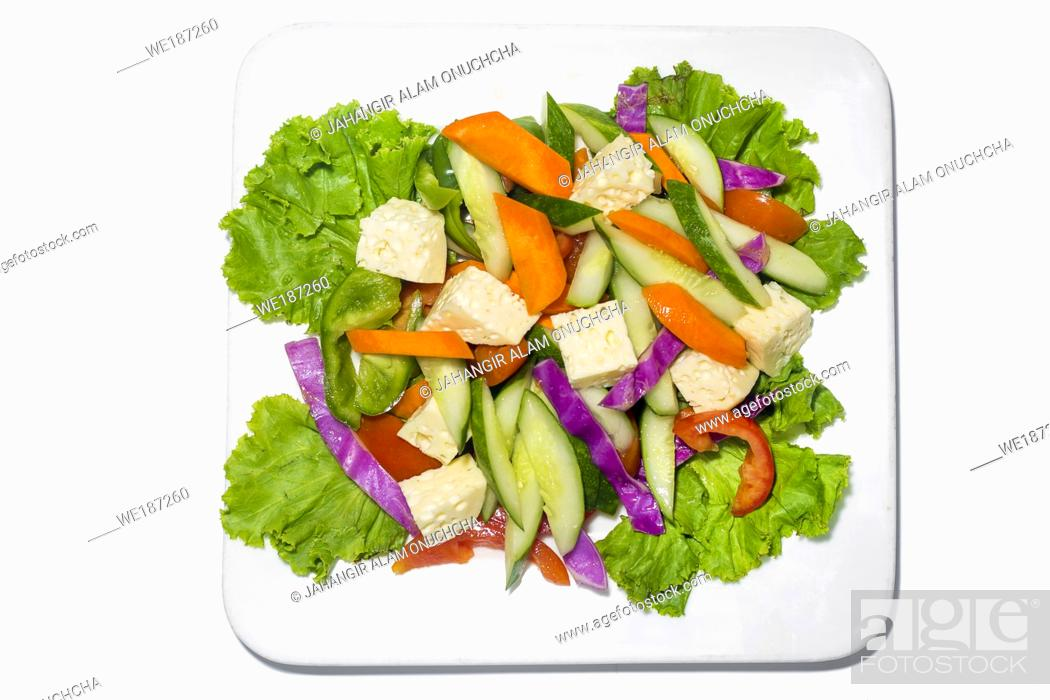 Stock Photo: Fresh green vegetable salad in a plate. Healthy capsicume, carrot, cheese, tomato and lettuce meal on white background.