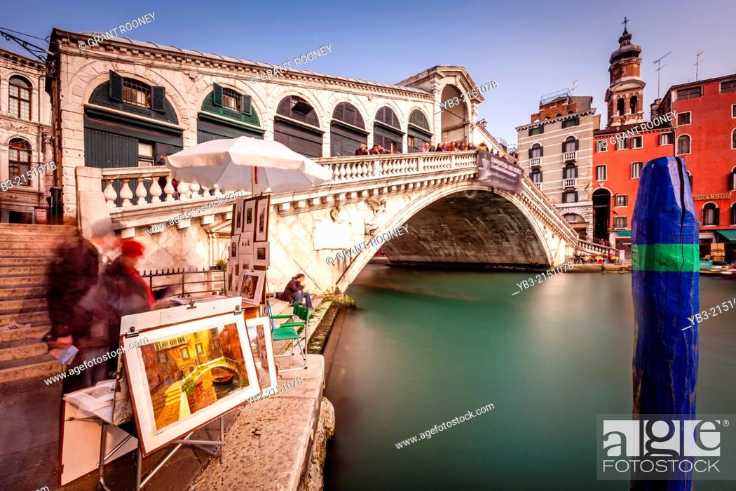 Stock Photo: Local Artist Selling Paintings By The Rialto Bridge, Venice, Italy.