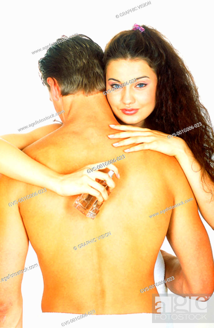 Stock Photo: Close-up of a woman hugging a bare chested man.
