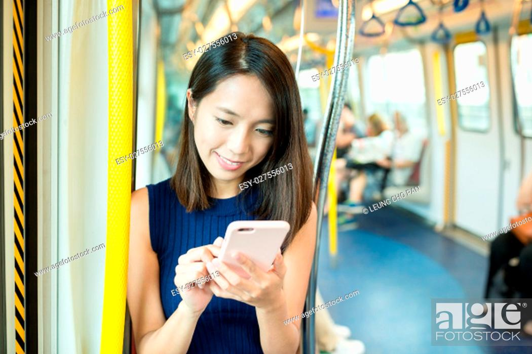 Stock Photo: Woman texting on mobile phone.