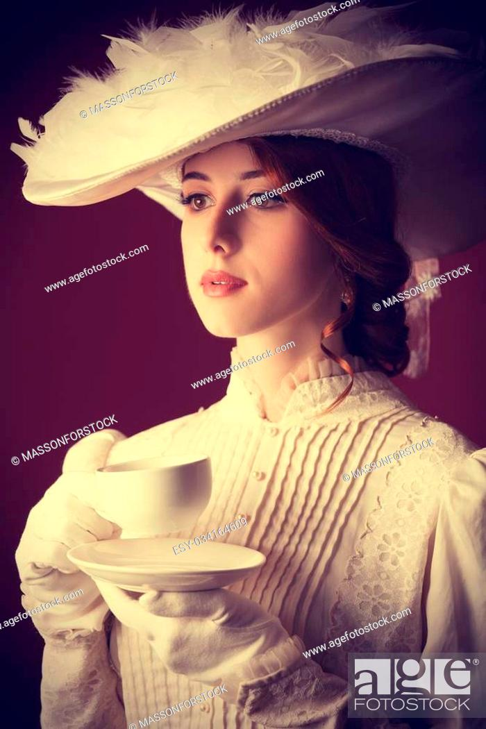 Stock Photo: Beautiful redhead women with cup of tea.