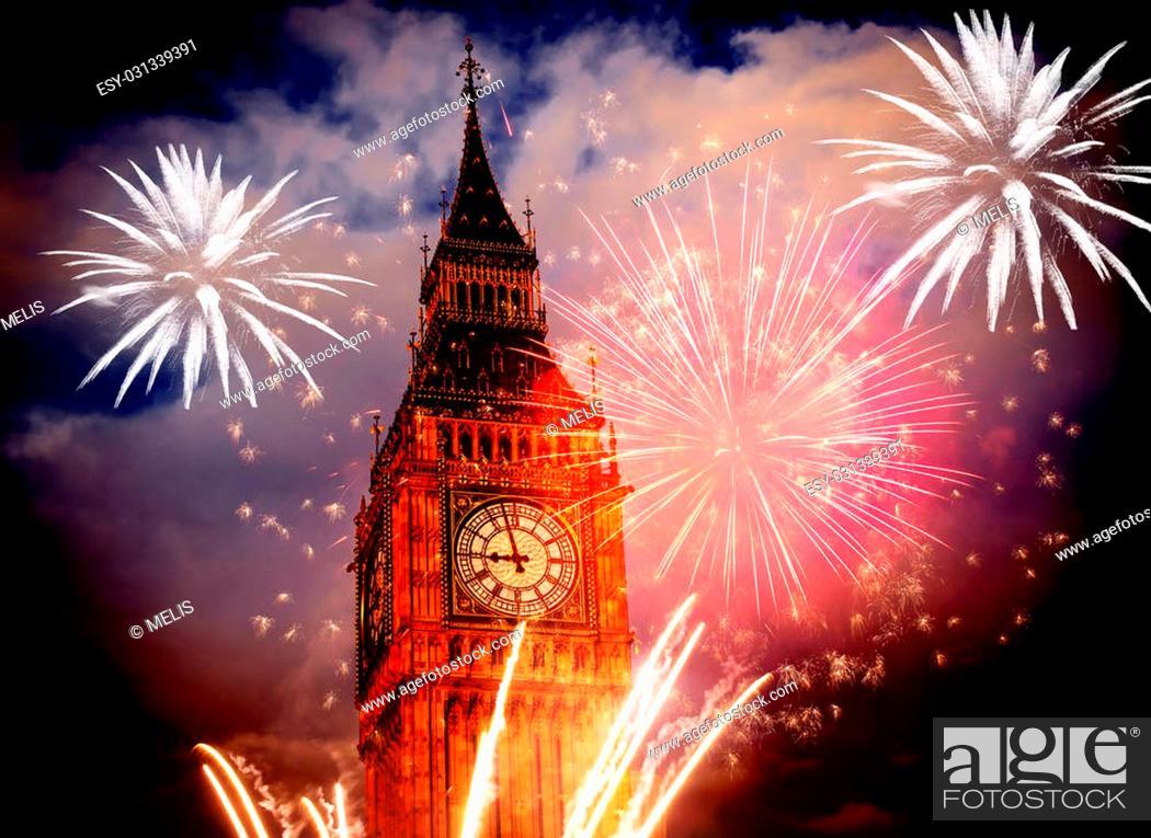 Stock Photo: Explosive fireworks display fills the sky around Big Ben. New Year's Eve celebration background.