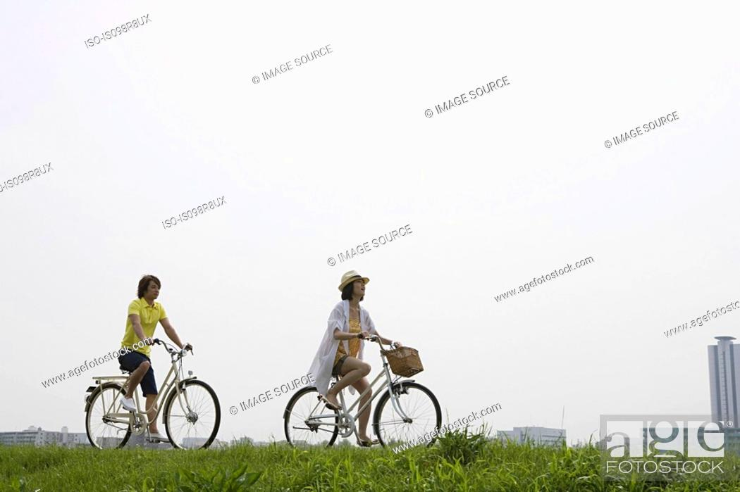 Stock Photo: Young couple cycling.