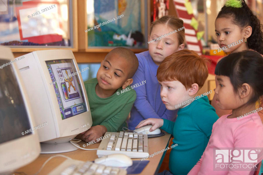 Stock Photo: Group of young children looking at computer.