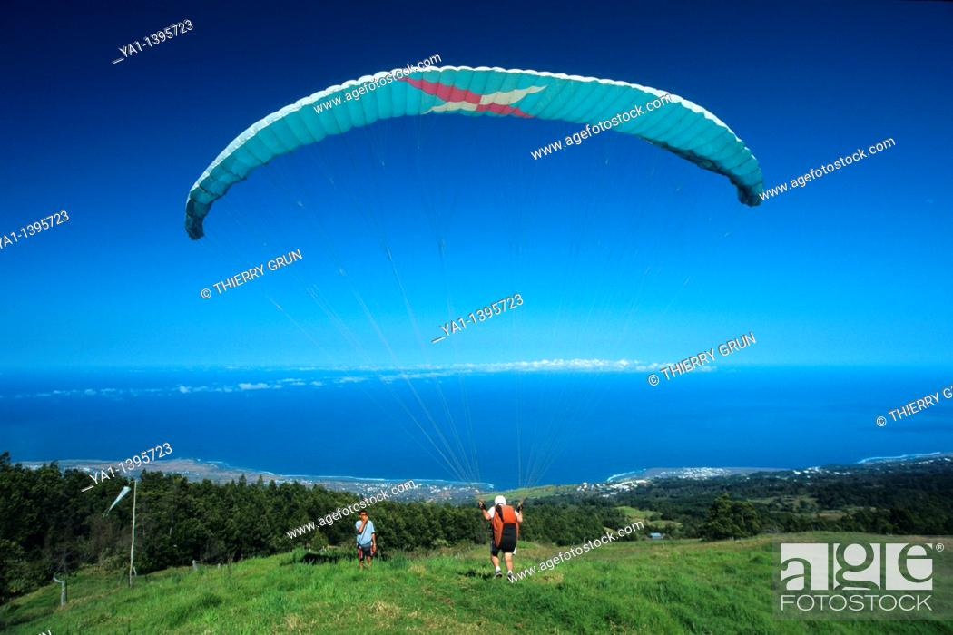 Stock Photo: Paraglider taking off over Saint Leu town, La Reunion Island (France), Indian Ocean.