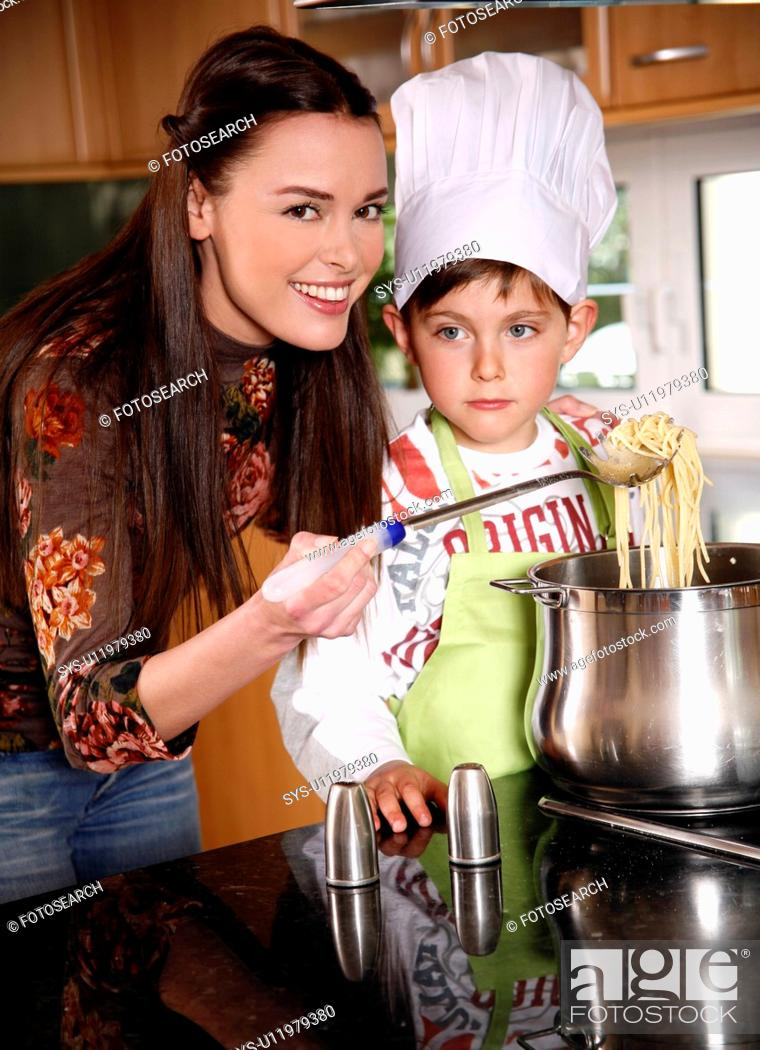 Stock Photo: Mother and son cooking spaghetti.