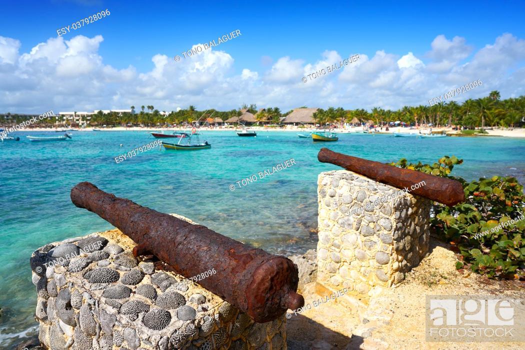 Stock Photo: Akumal beach rusted iron canon in Riviera Maya of Mayan Mexico.