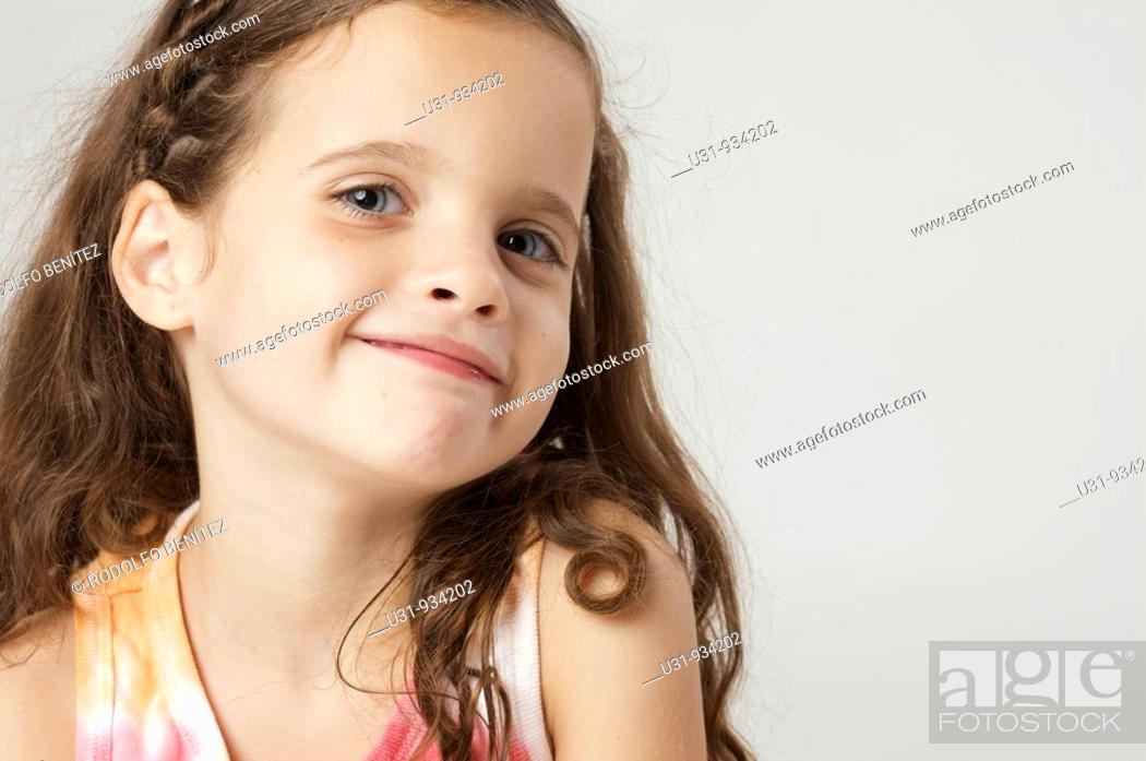 Stock Photo: Four year old girl smiling at the camera.