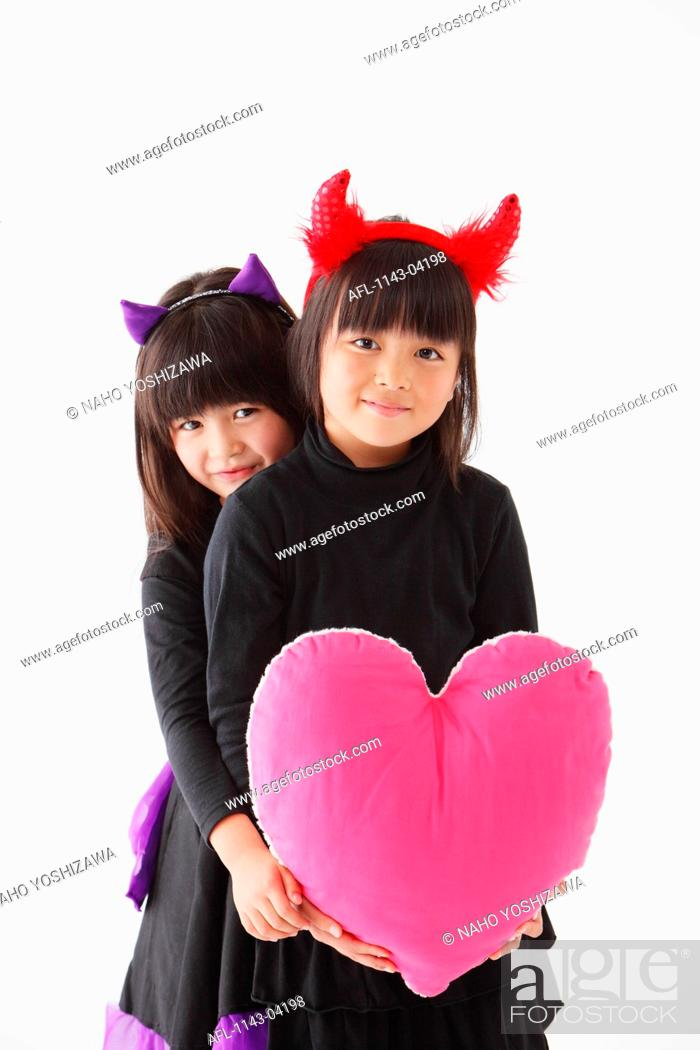 Two Girls In Halloween Costume Holding Heart Stock Photo Picture