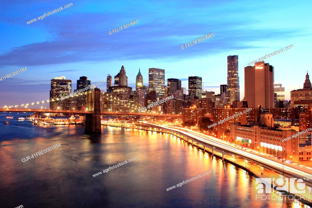 Stock Photo: Lower Manhattan and Brooklyn Bridge at night.