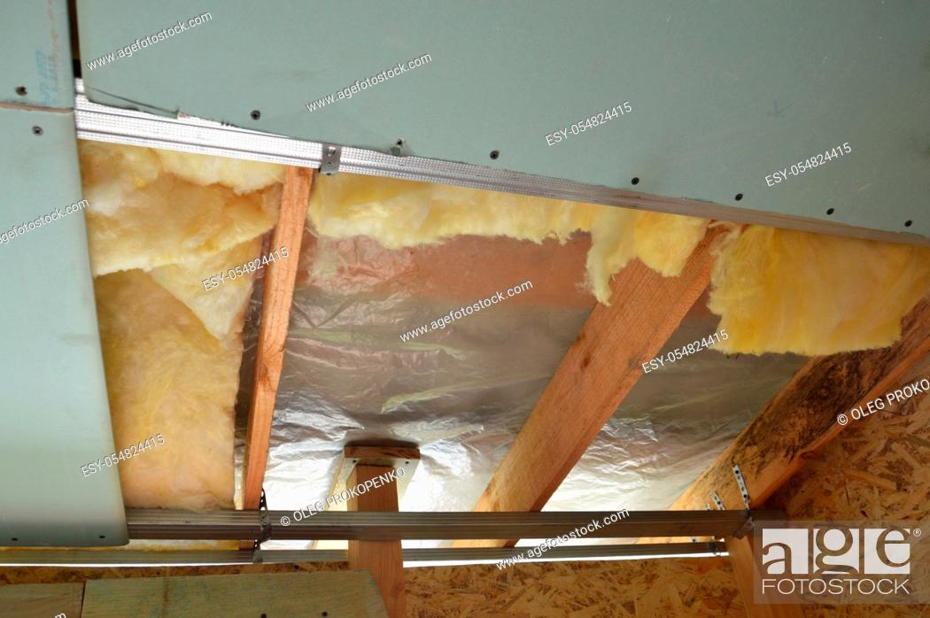 Stock Photo: Plasterboard ceiling lining and its the insulation.