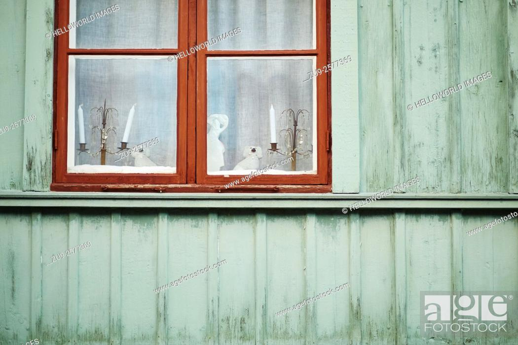 Stock Photo: Christmas decorations and candles in window of traditional wooden house, Stockholm, Sweden, Scandinavia.