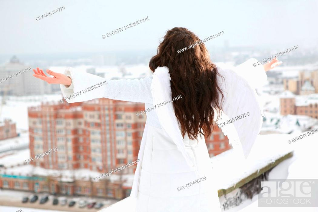 Stock Photo: Angel on the roof.
