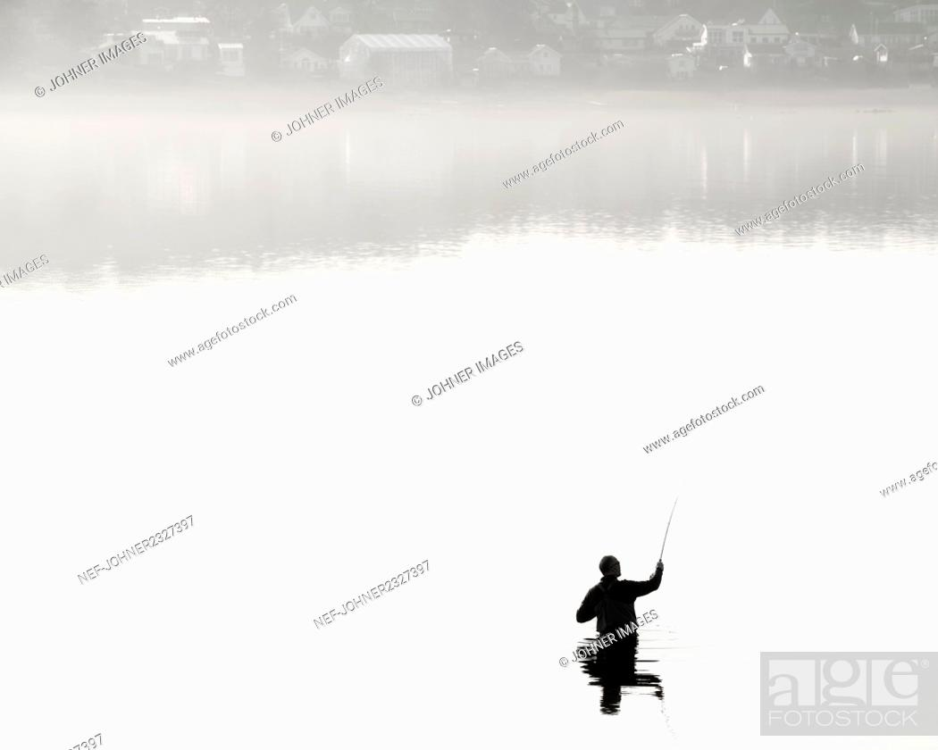 Stock Photo: Person fishing.