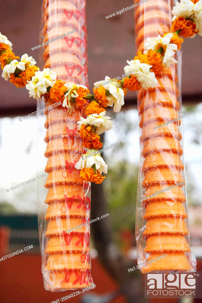 Stock Photo: Close-up of ice-cream cones with a garland.