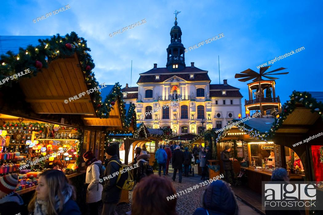 Stock Photo: People across the Christmas market at the city hall in Lueneburg, Germany, 29 November 2017. The Christmas market is open until 22 December.