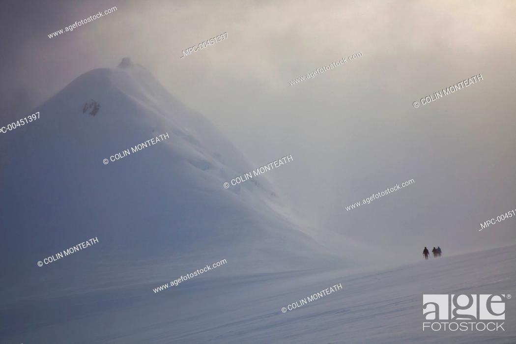 Stock Photo: Climbers descend Jabet Peak in blizzard above Port Lockroy, Wiencke Island, Antarctic Peninsula, Antarctica.