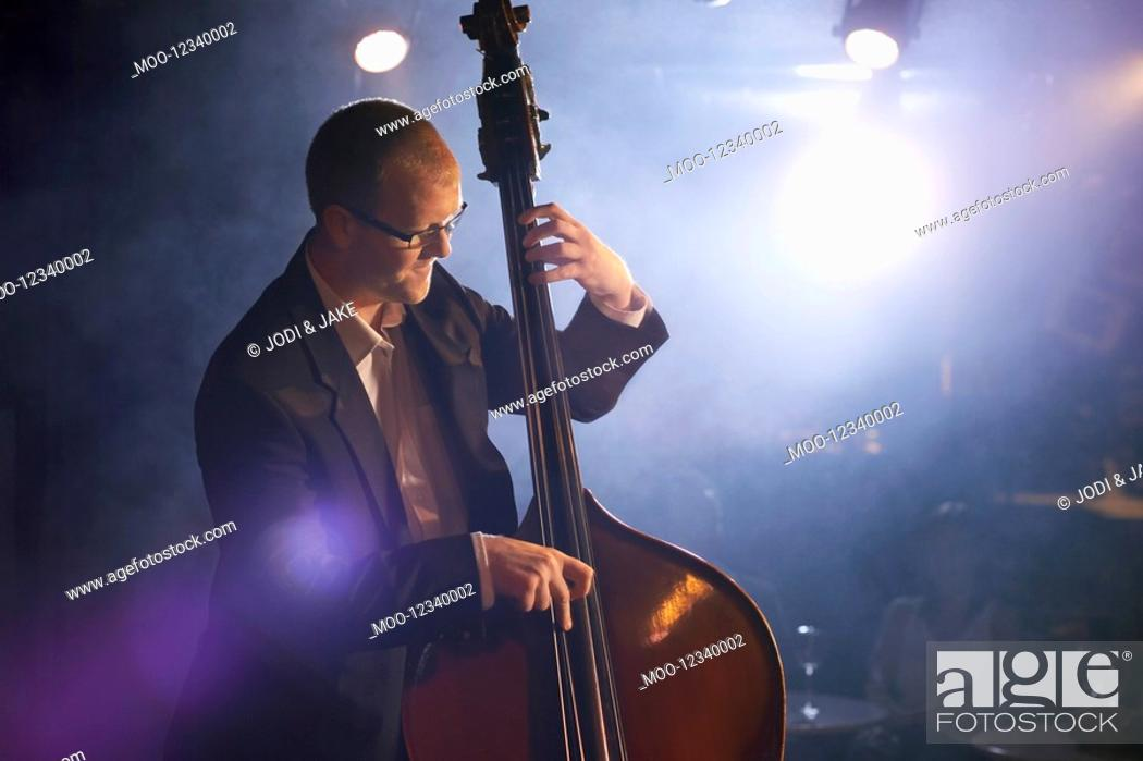 Stock Photo: Double bass player on stage portrait.