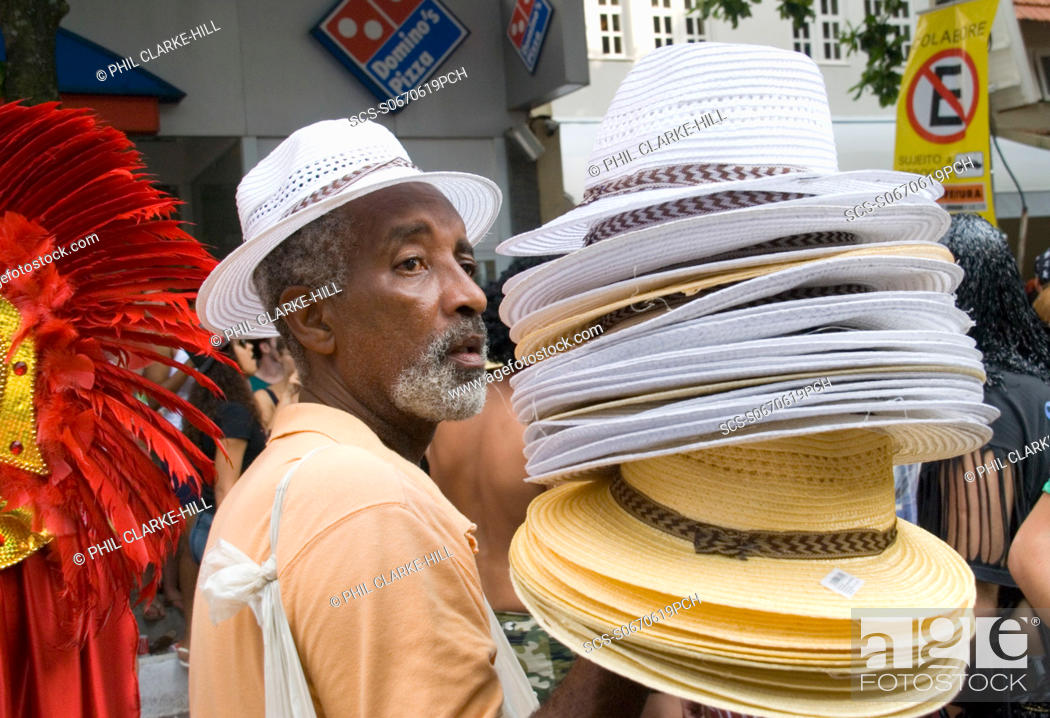 Stock Photo  Middle aged Brazillian male hat seller in Ipanema during  Carnival Mardis Gras 14838a27d7c