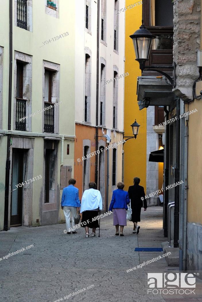Stock Photo: Ladies walking the streets of Llanes, Asturias.