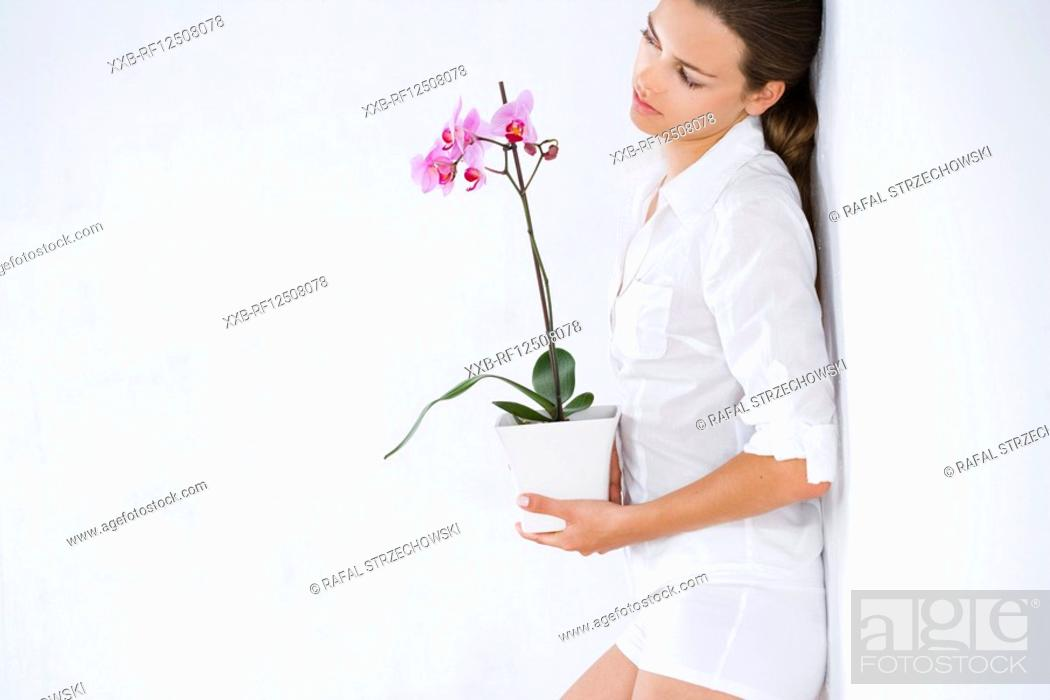 Stock Photo: young woman with orchid.