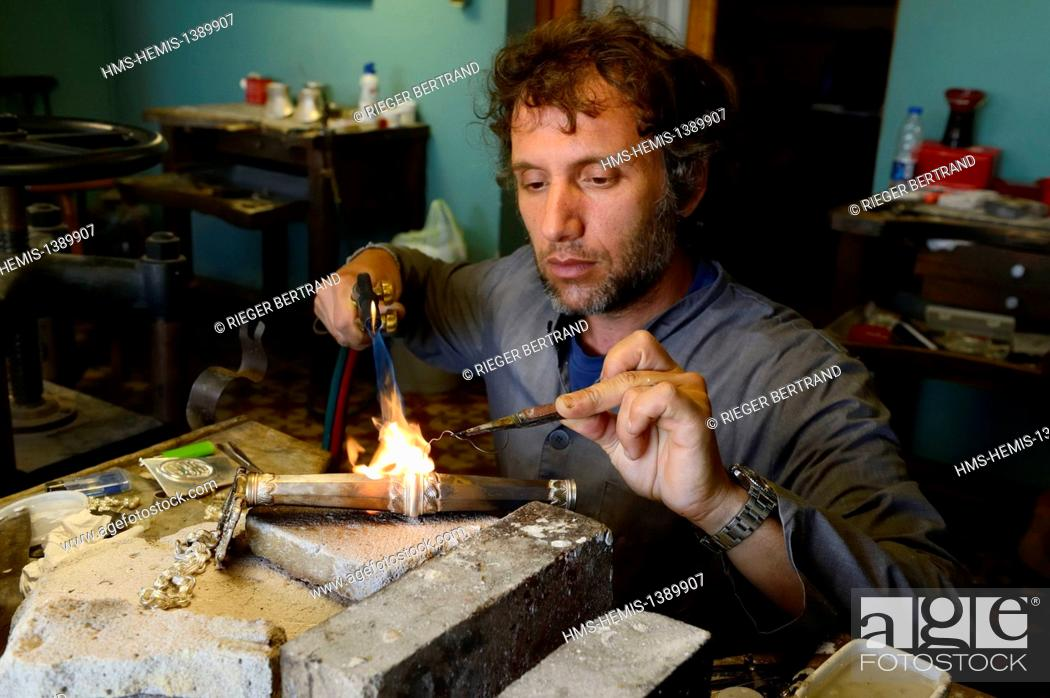 fc9b5f571203 Stock Photo - Argentina, Buenos Aires Province, San Antonio de Areco,  workshop of the silversmith Juan José Draghi, finishes on rebenque, silver  piece of a ...